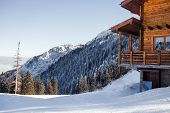 Winter Vacation Holiday Alpine Wooden House Skiing Relax Leisure Resort In The Mountains Covered Wit poster