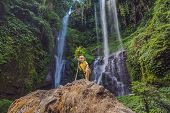 Cute Boy Depicts The King Of The Jungle Against The Backdrop Of A Waterfall. Childhood Without Gadge poster