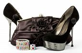 Sexy fashionable shoes, handbag and jewelry isolated on white background.