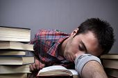 Young Man Sleeping On Books