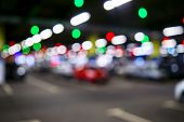 Blurred Cars In Car Parking Lot In Shopping Mall. Bokeh Lights Background. Abstract Blur Car Parking poster