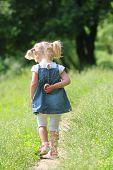 Beautiful Little Girl On Nature,