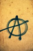 stock photo of anarchists  - Anarchist movement graffiti on a grunge texture - JPG