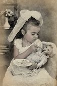 Little Girl Is Feeding Her Doll