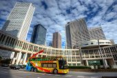 TOKYO - NOVEMBER 3: A tour bus passes the Metropolitan Assembly in Shinjuku November 3, 2012 in Toky