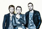 PARIS, FRANCE - JULY 04, 2012: Portrait of the english rock group Muse with  Matthew Bellamy, Domini