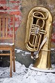 Old Chair And Tuba Outdoors