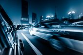 stock photo of dark side  - View from Side of Car Going Around Corner - JPG
