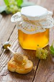 Honey on toast and honey in a glass jar