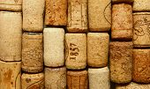 picture of bordeaux  - many different wine corks in the background - JPG