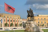 in the square dedicated to the national hero Skanderbeg dominates its equestrian statue and waving Albanian flag - Tirana