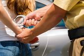 stock photo of policeman  - Police officer arresting a woman with handcuffs - JPG