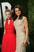 WEST HOLLYWOOD, CA - FEB 24: Samantha Barks, Amanda Seyfried at the Vanity Fair Oscar Party at Sunset Tower on February 24, 2013 in West Hollywood, California
