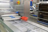 The image of a food packing industry equipment