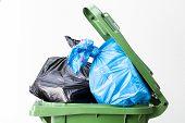 stock photo of dust-bin  - A close up of a full waste bin top - JPG