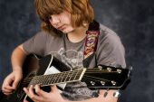 Preteen Practicing Guitar