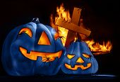 Closeup on scary Halloween decorations, eerie glowing blue carved pumpkin, eldritch spiders, cross a