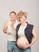 image of hillbilly  - Frustrated man with annoyed pregnant hillbilly woman - JPG