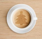 image of scum  - coffee cup with christmas tree shape on foam - JPG