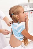 stock photo of respiratory disease  - Coughing little girl at the doctor  - JPG