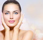 Beauty Portrait. Beautiful Spa Woman Touching her Face. Perfect Fresh Skin. Pure Beauty Model Girl.