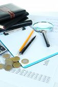 Office supplies with money and documents close up