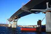 picture of flatboat  - bridge construction reaching over water view from beneath - JPG