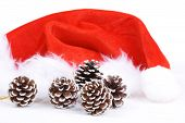 Santa Claus Hat And Pine Cones On White