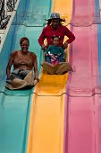 Family Goes Down Fun Slide At Atlanta Fair