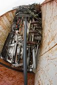 picture of ferrous metal  - container filled with ferrous material and old rusted iron parts in junkyard - JPG