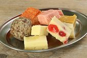 stock photo of gulab  - selection of delicious indian sweets on a metal dish - JPG