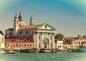 Grand Canal with boats and Basilica Santa Maria della Salute Venice Italy with a retro effect