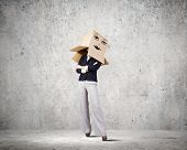 Confident businesswoman wearing carton box on head
