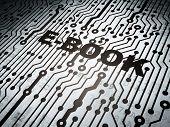 Education concept: circuit board with E-Book