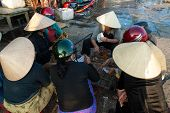 Playing Cards In The Fish Market Of Hoi An, Vietnam