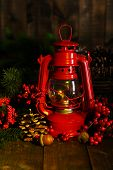 stock photo of kerosene lamp  - Red kerosene lamp on dark background - JPG