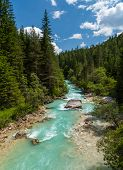 Mountainriver in the forest at Cortina D'Ampezzo in Italy