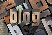 blog, word written with antique letterpress printing blocks on mixed letters background