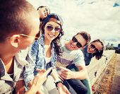 image of teenagers  - summer holidays and teenage concept  - JPG