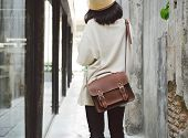 Fashion Girl With Leather Bag At Concrete Alleyway