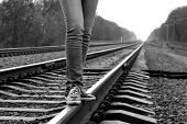 Girl Walking Across Railroad. B&w Image