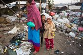 KATHMANDU, NEPAL - DEC 19, 2013: Unidentified children and parents are working on dump. In Nepal ann