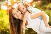 picture of daughter  - Beautiful mother and daughter having fun in the park on spring day - JPG