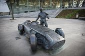STUTTGART, GERMANY - MARCH 30, 2014: Sculpture of Mercedes-Benz W196R Silberpfeil (1954) and race ca