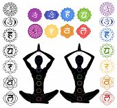 stock photo of kundalini  - silhouette in yoga position with the symbols of seven chakras - JPG