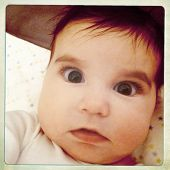 Instagram style portrait image of an infant