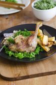image of roast duck  - Roast duck leg with steamed curly kale and roast parsnips - JPG