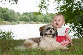 Baby And Puppy In Nature
