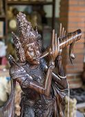 Traditional Carved Wooden Sculpture Of The Bali Island