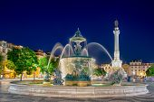Romantic Lisbon Street. Fountain At Night In The Center Of The City
